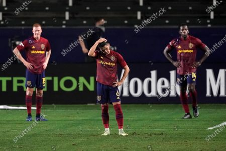 Real Salt Lake's Justen Glad, from left, Pablo Ruiz, and Nedum Onuoha stand on the field after the team's 2-1 loss to the Los Angeles Galaxy in an MLS soccer match, in Carson, Calif