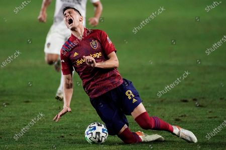 Stock Image of Real Salt Lake's Damir Kreilach falls to the ground after he was tackled by Los Angeles Galaxy's Giancarlo Gonzalez during the second half of an MLS soccer match, in Carson, Calif. The Galaxy won 2-1