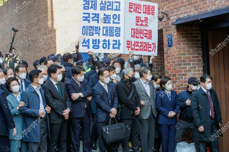 Former and incumbent lawmakers of South Korea's opposition People Power Party wait for former President Lee Myung-bak in front of his house in Seoul, South Korea, 02 November 2020. The Supreme Court on 29 October upheld a lower court ruling of a 17-year prison term for Lee, who was out on bail, for embezzlement and bribery.