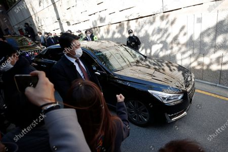 Vehicle carrying South Korea's former President Lee Myung-bak leaves his residence for the Seoul Central District Prosecutors' Office in Seoul, South Korea, . Lee was sent back to prison on Monday, four days after the country's top court upheld a 17-year prison term on him over corruption crimes
