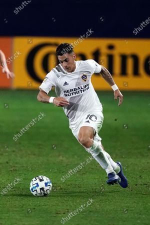 Los Angeles Galaxy's Cristian Pavon moves the ball during the second half of an MLS soccer match against the Real Salt Lake, in Carson, Calif