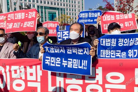 Stock Picture of Supporters protesting against former South Korean president Lee Myung-bak's confirmation of his 17-year prison sentence protest in front of the Seoul Eastern Detention Center, which insists on Lee's innocence