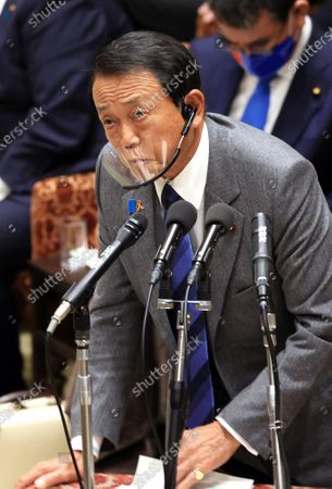 Japanese Finance Minister Taro Aso answers a question at Lower House's budget committee session at the National Diet in Tokyo on Monday, November 2, 2020.