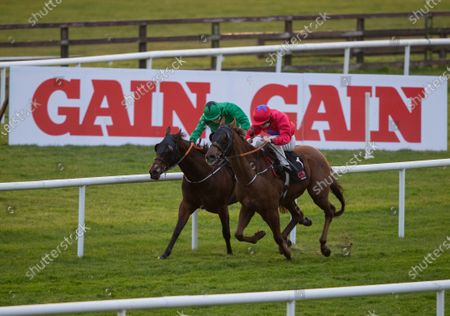 The GAIN Equine Nutrition Handicap . Colin Keane onboard Pretty Boy Floyd holds off Gary Hallpin onboard Glow Worm to win the race