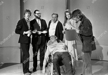 Stock Picture of Eric Idle, Dick Vosburgh, Benny Green, Marga Roche, Frank Muir, and Terry Gilliam