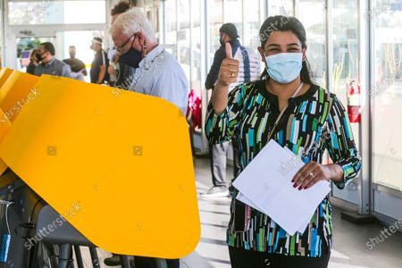 Sara Dhillon gives a thumb up after voting first time at early polling station on roof top at Kimpton La Peer Hotel on Friday, Oct. 30, 2020 in West Hollywood, CA. (Irfan Khan / Los Angeles Times)