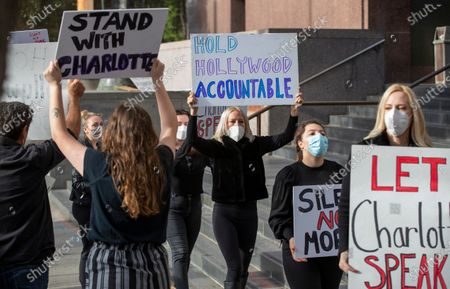 Stock Photo of Activists protest a court ruling that has kept actress Charlotte Kirk from discussing terms of a confidential alleged Hollywood studio moguls sex scandal settlement at Los Angeles Superior Court on Monday, Oct. 26, 2020 in Los Angeles, CA. Charlotte Kirk, who did not show up at the protest, was at the center of two high profile sex scandals involving top studio moguls. (Allen J. Schaben / Los Angeles Times)