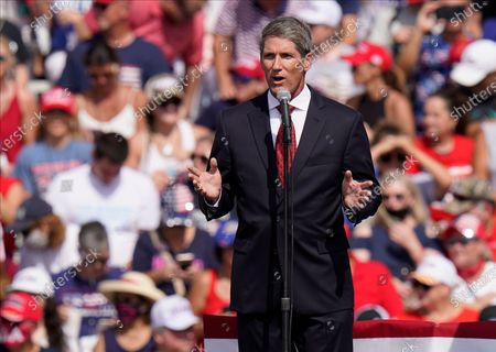 Scott Franklin, Republican candidate for the U.S. House of Representatives, speaks before President Donald Trump, and First Lady Melania Trump at a campaign rally, in Tampa, Fla