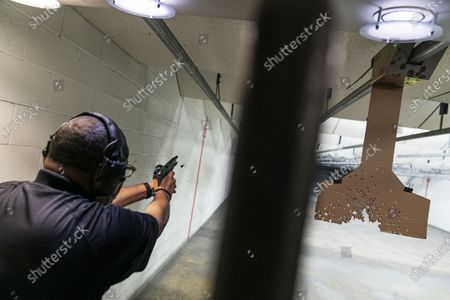 "Chad King, who started the Detroit chapter of the National African American Gun Association and teaches de-escalation training, practices at a shooting range in Taylor, Mich., Wed, . King started his group in 2017 to promote responsible gun ownership in the Black community. Now the nation is on edge contemplating the added threat of possible clashes in the wake of Election Day. Some of his students sought gun ownership as far right groups appear to them to have become more emboldened. Weeks ago, a group of white men were arrested for allegedly plotting to kidnap the Democratic governor of Michigan. Trump has refused to promise a peaceful transfer of power. He told a far-right group to ""stand back and stand by"