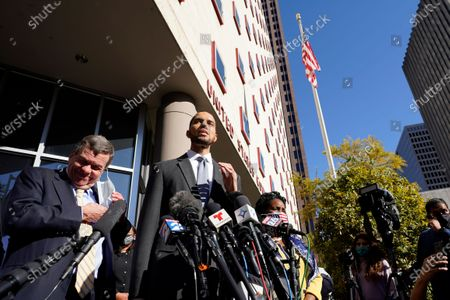 Harris County Clerk Chris Hollins speaks outside the federal courthouse after a hearing, in Houston. A federal judge has rejected a last-ditch Republican effort to invalidate nearly 127,000 votes in Houston. U.S. District Judge Andrew Hanen's ruling Monday concerned ballots cast at drive-thru polling centers that were established during the pandemic. The lawsuit was brought by conservative Texas activists who have railed against expanded voting access in Harris County