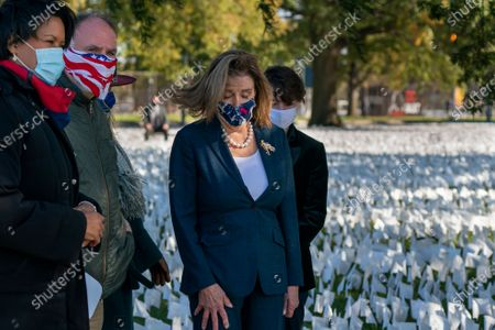 Speaker of the House Nancy Pelosi, D-Calif., attends an event to draw attention to a memorial that honors Americans who have died during the COVID-19 pandemic, in Washington, . She is joined at left by Washington Mayor Muriel Bowser and chef Jose Andres