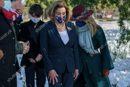 Stock Picture of Speaker of the House Nancy Pelosi, D-Calif., attends a memorial that honors Americans who have died during the COVID-19 pandemic, in Washington, . She is joined at left by chef Jose Andres and artist Suzanne Firstenberg at right