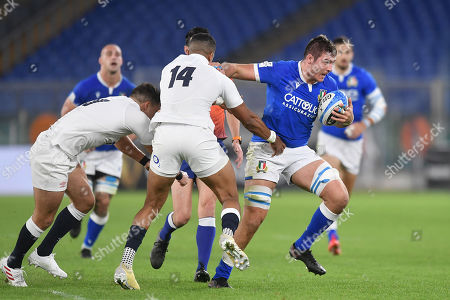 Stock Photo of Jake Polledri - Italy number 8 hands off England winger Anthony Watson (14).