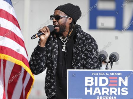 US rapper 2 Chainz speaks during a GOTV Voter Mobilization Drive-In Rally which fomer US President Barack Obama will address in a parking lot at Turner Field the day before the US Presidential election in Atlanta, Georgia, USA 02 November 2020.