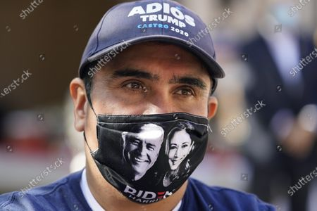 Stock Image of Andres Lopez listens to Democratic U.S. Senate candidate MJ Hegar during a campaign stop, in San Antonio