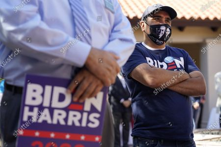 Andres Lopez listens to Democratic U.S. Senate candidate MJ Hegar during a campaign stop, in San Antonio