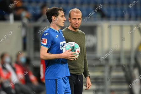 Sebastian Hoeness, head coach of Hoffenheim looks at his player Sebastian Rudy (L) during the German Bundesliga match between TSG Hoffenheim and 1. FC Union Berlin at PreZero-Arena in Sinsheim, Germany, 02 November 2020.