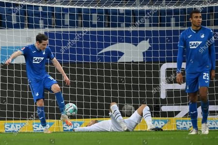 (L-R) Sebastian Rudy of Hoffenheim, his keeper Oliver Baumann and Kevin Akpoguma react after receiving the 2nd goal  during the German Bundesliga match between TSG Hoffenheim and 1. FC Union Berlin at PreZero-Arena in Sinsheim, Germany, 02 November 2020.