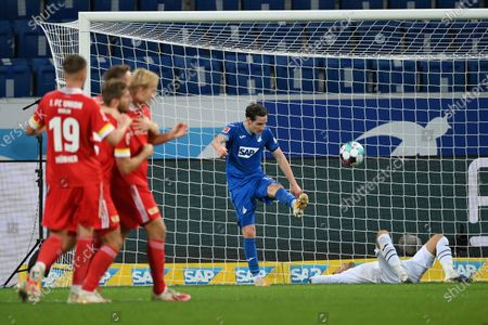Stock Photo of Sebastian Rudy (C) of Hoffenheim and his goal keeper Oliver Baumann react after receiving the 2nd goal  during the German Bundesliga match between TSG Hoffenheim and 1. FC Union Berlin at PreZero-Arena in Sinsheim, Germany, 02 November 2020.