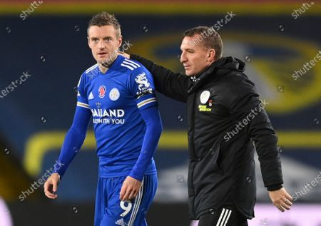 Leicester's Jamie Vardy, left and Leicester's manager Brendan Rodgers walk from the pitch after the end of the English Premier League soccer match between Leeds United and Leicester City at Elland Road in Leeds, England, .Leicester won the match 4-1