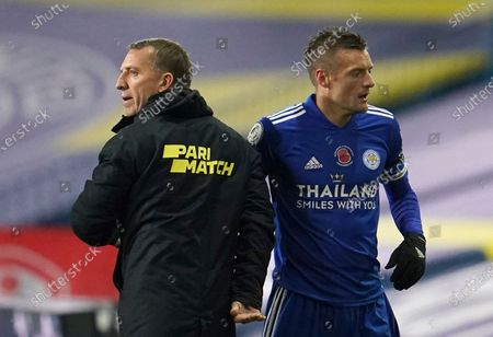 Leicester's Jamie Vardy, right shakes hands with Leicester's manager Brendan Rodgers after being substituted during the English Premier League soccer match between Leeds United and Leicester City at Elland Road, in Leeds, England