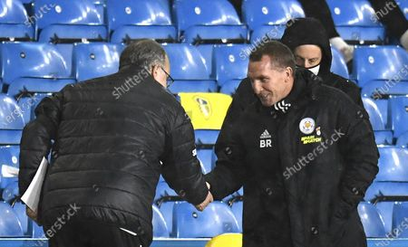 Leicester City manager Brendan Rodgers (R) and Leeds manager Marcelo Bielsa (L) greet ahead of the English Premier League soccer match between Leeds United and Leicester City in Leeds, Britain, 02 November 2020.