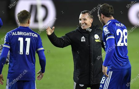 Marc Albrighton (L) and Christian Fuchs (R) of Leicester react with Leicester City manager Brendan Rodgers (C) after the English Premier League soccer match between Leeds United and Leicester City in Leeds, Britain, 02 November 2020.