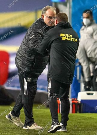 Leicester City manager Brendan Rodgers (R) and Leeds manager Marcelo Bielsa (L) greet after the English Premier League soccer match between Leeds United and Leicester City in Leeds, Britain, 02 November 2020.