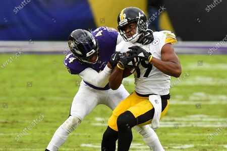 Pittsburgh Steelers wide receiver JuJu Smith-Schuster (19) runs the ball against Baltimore Ravens cornerback Marlon Humphrey (44) during the second half of an NFL football game, in Baltimore