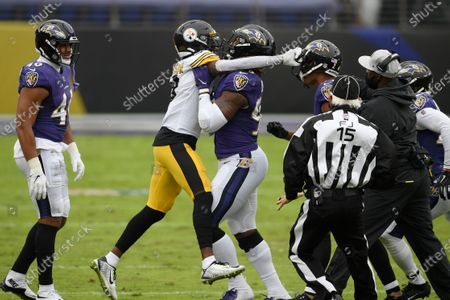 Stock Photo of Baltimore Ravens outside linebacker Matt Judon, center, pushes Pittsburgh Steelers wide receiver Diontae Johnson, center left, away during an altercation with Ravens cornerback Marcus Peters, center right, during the first half of an NFL football game, in Baltimore