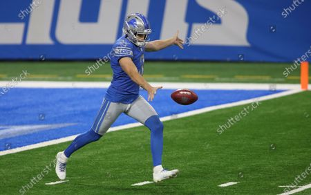 Stock Photo of Detroit Lions punter Jack Fox (3) kicks a punt during the first half of an NFL football game against the Indianapolis Colts, in Detroit