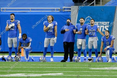 Detroit Lions' Jesse James (83), D'Andre Swift (32), T.J. Hockenson (88), Chase Daniel (4), Danny Amendola (80) and Matthew Stafford (9) during the national anthem for an NFL football game against the Indianapolis Colts, in Detroit