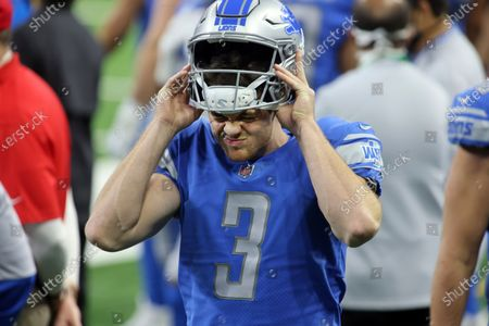 Detroit Lions punter Jack Fox (3) puts on his helmet on the sidelines during the first half of an NFL football game against the Indianapolis Colts, in Detroit
