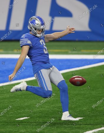 Stock Image of Detroit Lions punter Jack Fox (3) kicks a punt during the first half of an NFL football game against the Indianapolis Colts, in Detroit