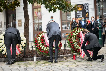 Stock Photo of Austrian Chancellor Sebastian Kurz (R), President of the Austrian National Council Wolfgang Sobotka (L) and President of Austria Alexander Van der Bellen (C) attend a wreath laying ceremony after multiple shootings in the first district of Vienna, Austria, 03 November 2020. According to recent reports, at least three persons are reported to have died and many are seriously injured in what officials treat as a terror attack which took place in the evening of 02 November.
