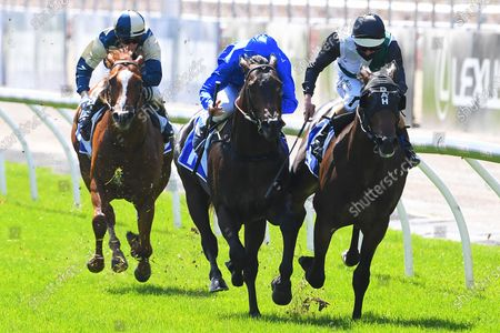 Jockey Luke Nolen (right) rides Finance Tycoon to victory in race 1, the Darley Maribyrnong Plate during Melbourne Cup Day at Flemington Racecourse in Melbourne, Australia, 03 November 2020.