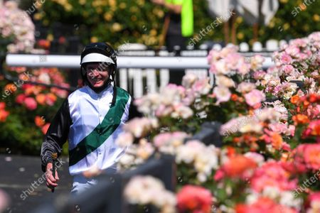 Stock Photo of Jockey Luke Nolen walks back to scale after riding Finance Tycoon to victory in race 1, the Darley Maribyrnong Plate during Melbourne Cup Day at Flemington Racecourse in Melbourne, Australia, 03 November 2020.