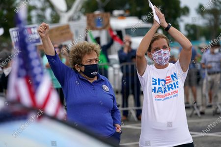 Rep. Donna Shalala, D-Fla., left, stands with Rep. Debbie Wasserman Schultz, D-Fal., right, before an appearance by former President Barack Obama at a campaign rally for Democratic presidential candidate former Vice President Joe Biden, in Miami