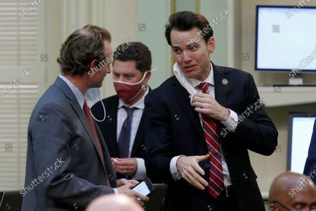 Republican Assemblymen James Gallagher, of Yuba City, left, and Kevin Kiley, of Rocklin, confer at the Capitol in Sacramento, Calif. A Northern California county judge, preliminarily ordered Gov. Gavin Newsom to stop issuing directives related to the coronavirus that might interfere with state law. Sutter County Superior Court Judge Sarah Heckman tentatively ruled that one of the dozens of executive orders Newsom has issued overstepped his authority and impinged on the state Legislature. Heckman acted in a lawsuit brought by Gallagher and Kiley, who said Newsom, a Democrat, was single-handedly overriding state laws in the name of keeping Californians safe
