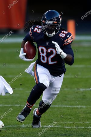 Chicago Bears wide receiver Dwayne Harris (82) returns a punt against the New Orleans Saints during an NFL football game in Chicago, . The Saints won the game in overtime 26-23