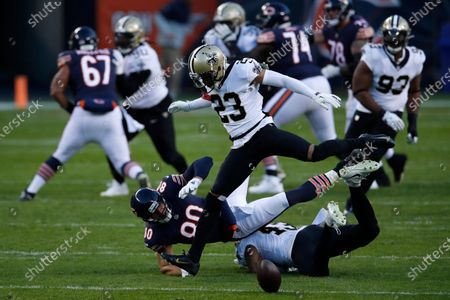 New Orleans Saints free safety Marcus Williams (43) and cornerback Marshon Lattimore (23) break up a pass intended for Chicago Bears tight end Jimmy Graham (80) during an NFL football game in Chicago, . The Saints won the game in overtime 26-23