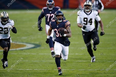 Chicago Bears running back David Montgomery (32) runs the ball against the New Orleans Saints during an NFL football game in Chicago, . The Saints won the game in overtime 26-23