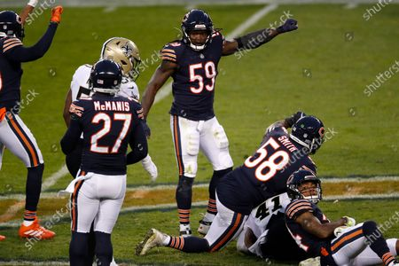 Chicago Bears inside linebacker Danny Trevathan (59) reacts after a stop against the New Orleans Saints during an NFL football game in Chicago, . The Saints won the game in overtime 26-23