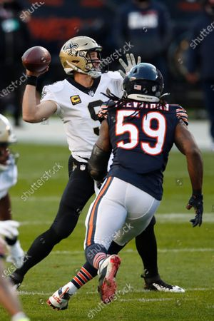 New Orleans Saints quarterback Drew Brees (9) throws a pass while being pressured by Chicago Bears inside linebacker Danny Trevathan (59) during an NFL football game in Chicago, . The Saints won the game in overtime 26-23
