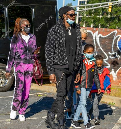 Rapper 2 Chainz and family arrive at a Drive-in Mobilization Rally to get out the vote for Georgia Senate candidates on November 2, 2020 in Atlanta, Georgia. Republican Sens. David Perdue and Kelly Loeffler are locked in a tight battle with Democrats Jon Ossoff and Raphael Warnock for the Senate seats in Georgia.