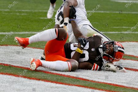 Cleveland Browns wide receiver Jarvis Landry (80) lies in the end zone after getting hit during an NFL football game against the Las Vegas Raiders, in Cleveland