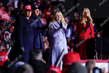 President Donald Trump listens as Ivanka Trump speaks during a campaign rally at Kenosha Regional Airport, in Kenosha, Wis. Listening are Jared Kushner and Tiffany Trump