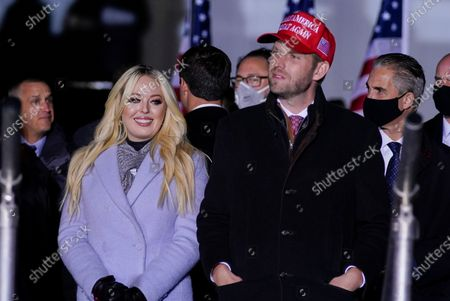 Tiffany Trump and Eric Trump listen as President Donald Trump speaks during a campaign rally at Kenosha Regional Airport, in Kenosha, Wis