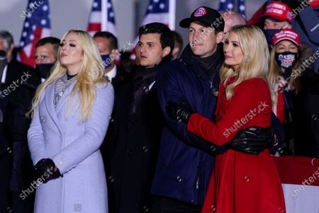 Tiffany Trump and Ivanka Trump and her husband Jared Kushner listen as President Donald Trump speaks during a campaign rally at Kenosha Regional Airport, in Kenosha, Wis