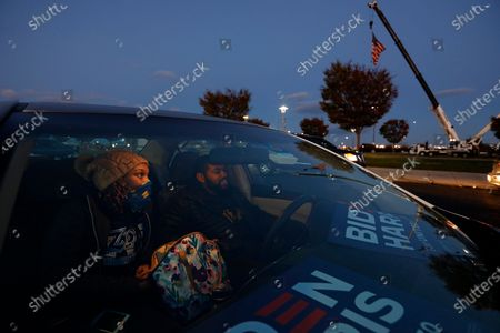 Supporters of Senator Kamala Harris get ready for her arrival at the drive- rally Monday night, Nov.2, 2020 at Citizens Bank Park parking lot. Mariah Jones, left, and Keith Jones, right, of Philadelphia, stay warm in the car as they wait the arrival of Sen. Harris.